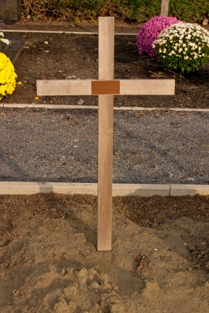 christian candle: Cemetery Cross on a Graveyard with All Saints Day
