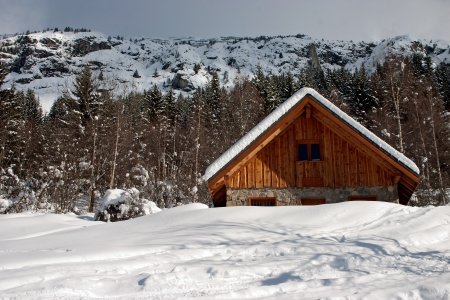 Chalet covered with snow in the French Alps photo