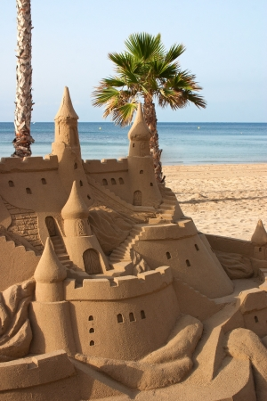 Sand Sculpture of a castle at the beach 写真素材