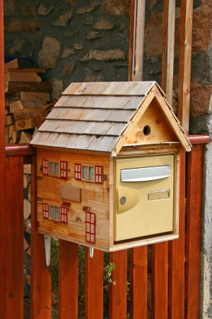 wooden post: A wooden post box in the French Alps
