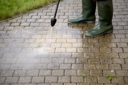 Outdoor floor cleaning with high pressure water jet Reklamní fotografie - 20831080