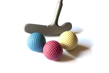 Mini Golf Stick with colored balls on an isolated background Imagens