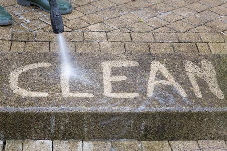 Outdoor floor cleaning with high pressure water jet