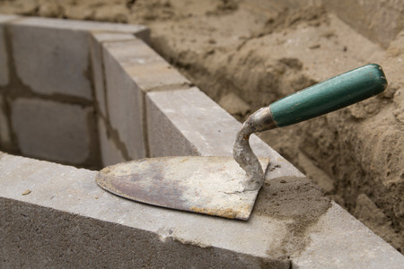 Empty trowel on a constructed wall outdoors photo