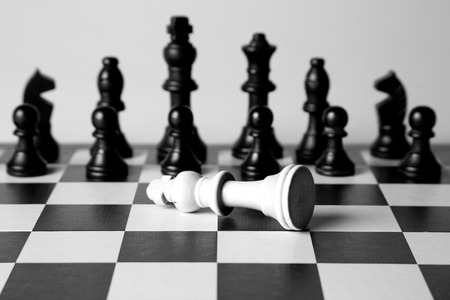 war: Black and white king on a chess board