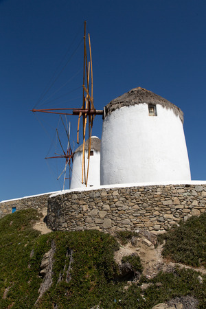 The famous wind mills in Mykoos during day time photo