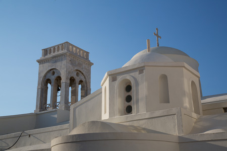 The white church on the top of Chora at the Naxos island at the Cyclades of the Aegean sea in Greece photo
