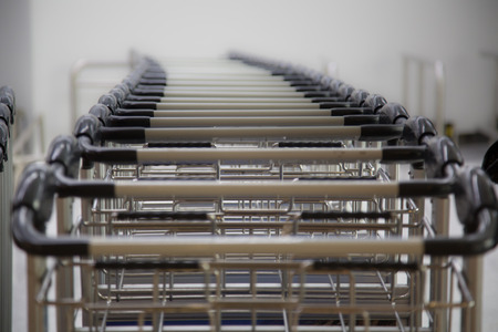 trolly: A row of luggage carts at the departure hall in the airport
