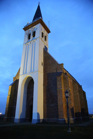 The typical white church of Den Hoorn in Texel photo