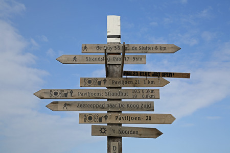 A tower with signs on the beach in Texel Standard-Bild