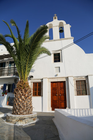 A white church in Chora at the Naxos island at the Cyclades of the Aegean sea in Greece photo