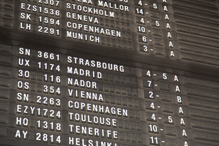 flight board: Airport departure board in terminal with flight information