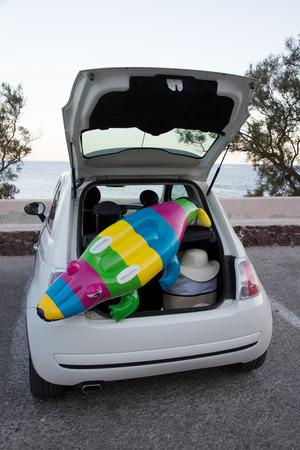 car trunk: The car trunk full of beach accessories