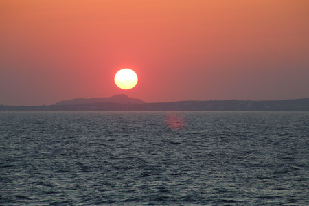 Sunset at the Portara Gate of the Apollo Temple in Naxos island photo