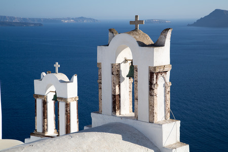 domes: Blue domes and their bell tower in Oia. Santorini