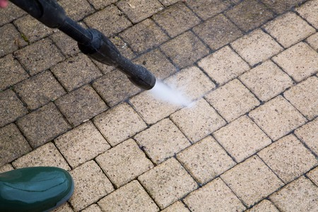pressure washing: Outdoor floor cleaning with high pressure water jet