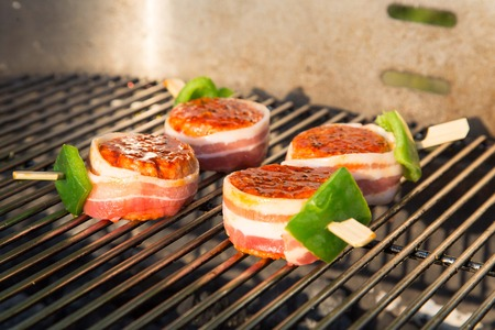 Grilled meat on a summer barbecue in the garden Stock Photo - 42203457