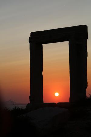 apollo: The Portara Gate of the Apollo Temple in Naxos island Stock Photo