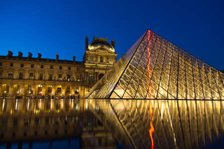 louvre pyramid: PARIS, FRANCE - JUN 18, 2014: Famous Louvre Museum Pyramid made of glass in Paris France on Jun 18, 2014. Editorial