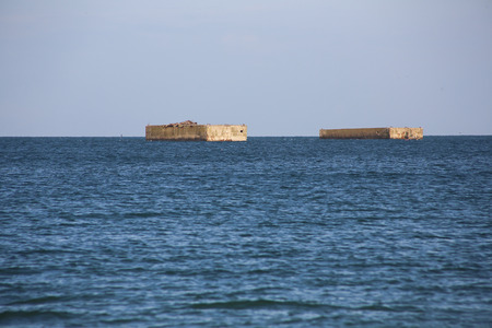 allies: Ruins of harbor built by the Allies in Arromanches, Normandy, France