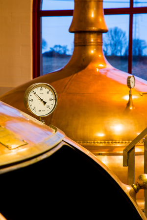 Traditional copper distillery tanks in a beer brewery Imagens