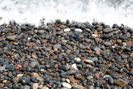 volcanic stones: The Kamari beach with black volcanic stones at Santorini island, Greece