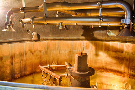 Traditional copper distillery tanks in a beer brewery Stock Photo