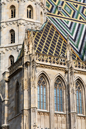 saint stephen cathedral: St. Stephens Cathedral with ornately patterned, multi colored roof in Vienna, Austria