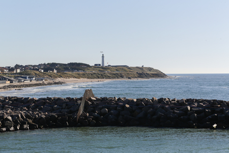 The coastline of Hirtshals and a lighthouse in the background