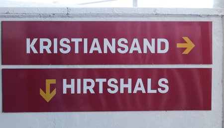 The sign towards Hirtshals and Kristiansand on board of the ferry Stock Photo