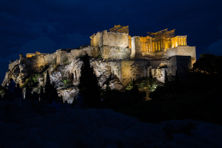 The Acropolis and Parthenon at night in Athens, Greece Stock Photo
