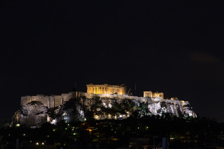 The Acropolis and Parthenon at night in Athens, Greece 写真素材
