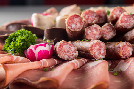 Assortment of meat delicatessen on a plate