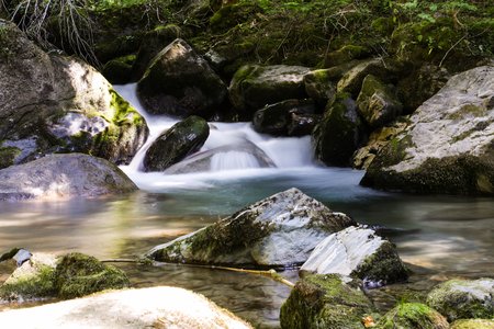 The soft water of a waterfall in the French Alps 写真素材