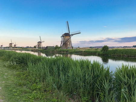 Beautiful dutch windmill landscape at the famous Kinderdijk canals