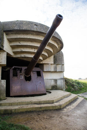 Old broken German bunkers of Atlantic Wall and artillery battery of Longues sur Mer