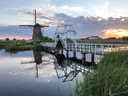 Beautiful dutch windmill landscape at the famous Kinderdijk canals, UNESCO world heritage site