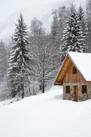 Chalet covered with snow in the French Alps