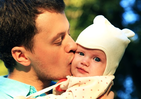 25 30 years: young father kissing his happy daughter