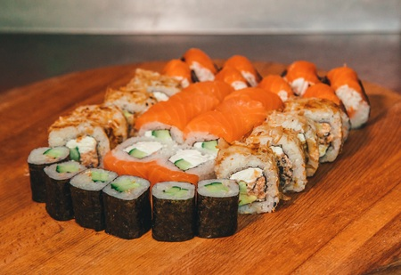 tasty sushi set on a wooden tray