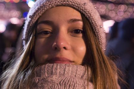 girl at the christmas fair at evening