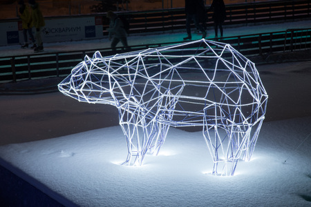 bear shape light installation at night