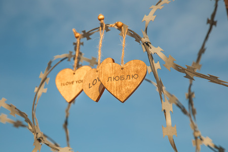 wooden hearts on the prison wall Stock Photo