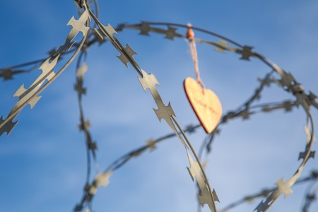 forbidden love: wooden hearts on the prison wall Stock Photo