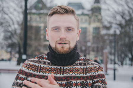 a man in a sweater at outside