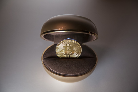 bitcoin inside the box for the ring Stock Photo