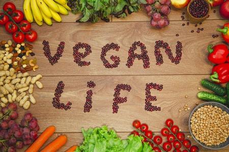 Go vegan concept green organic vegetables & bean on wood