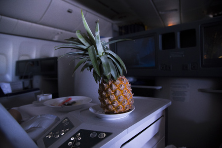 Fresh yellow pineapple on the table in the plane 免版税图像