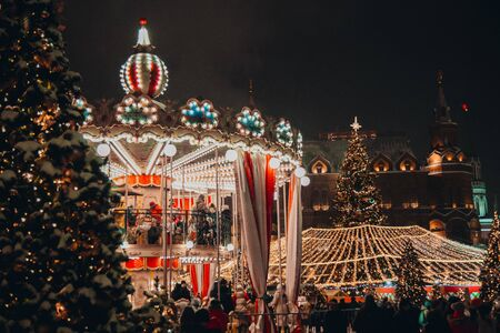 26 December 2018, Moscow , Russia . People ride on the carousel in a park
