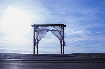Beautiful and Romatic wedding arch tent on the beach by the sea